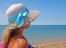 Young woman on a beach in a straw hat Royalty Free Stock Images