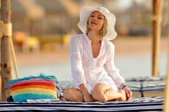 Young woman on the beach in summer Stock Photos