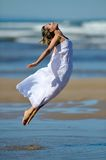 Young woman on the beach in summer Royalty Free Stock Image