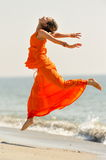 Young woman on the beach in summer Stock Photography