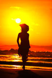 Young woman on the beach in summer sunset Royalty Free Stock Photography