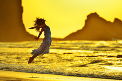 Young woman on the beach in summer sunset light Royalty Free Stock Image