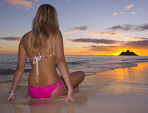 Young woman on beach at sunrise Royalty Free Stock Photo