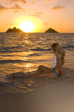 Young woman on beach at sunrise Royalty Free Stock Photos