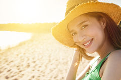 Young woman on the beach at sunset Stock Image