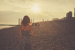 Young woman on the beach at sunset Royalty Free Stock Photography