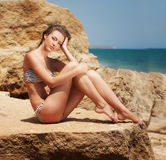 Young woman on the beach. In swimsuit Royalty Free Stock Photos
