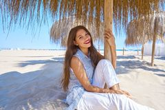 Young woman in a beach under parasol. Young latin woman in a beach under parasol at summer Royalty Free Stock Photography
