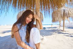 Young woman in a beach under parasol. Young latin woman in a beach under parasol at summer Royalty Free Stock Image