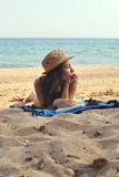 Young Woman on the Beach wearing a Straw Hat Stock Photos