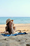 Young Woman on the Beach wearing a Straw Hat Royalty Free Stock Image