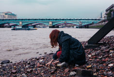 Young woman beachcombing in city Royalty Free Stock Images