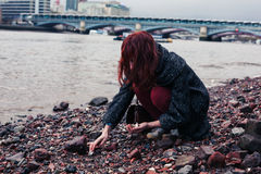 Young woman beachcombing in city Royalty Free Stock Photography