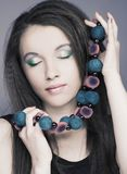 Young woman  with beads Royalty Free Stock Image