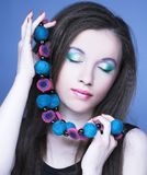 Young woman  with beads Royalty Free Stock Photos