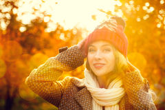 Young Woman in Beanie Hat on Autumn Background Stock Photography