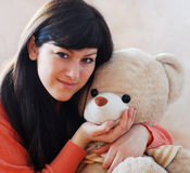 Young woman and bear Royalty Free Stock Image