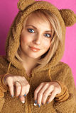 Young woman in bear suit Stock Photos