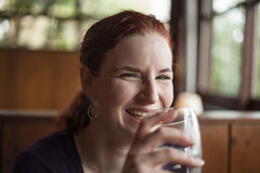 Young Woman with Beautiful Auburn Hair Drinking Water stock photography