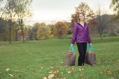 Young woman in beautiful autumn park, concept. A Young woman in beautiful autumn park, concept autumn royalty free stock image
