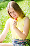 Young woman beautiful blond eating strawberries Royalty Free Stock Photos
