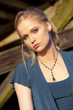 Young Woman with Beautiful Blue Eyes. Portrait of a young woman staring straight ahead into the camera Royalty Free Stock Image