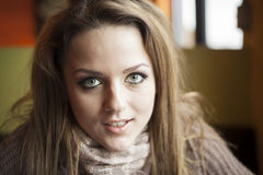 Young Woman with Beautiful Blue Eyes. Portrait of a young woman staring straight ahead into the camera Royalty Free Stock Photo