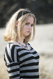 Young Woman with Beautiful Blue Eyes at the Beach Royalty Free Stock Photo