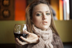 Young Woman with Beautiful Blue Eyes Drinking Red Wine stock photos