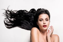 Young woman with beautiful composed black hair. Isolated on white royalty free stock image