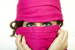 Young Woman With Beautiful Eyes Wearing Scarf. A young woman wears a warm pink scarf, accentuating her beautiful blue eyes in the cold winter weather Stock Image