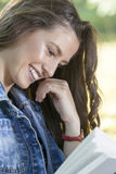 Young woman with a beautiful face carefully reads the book Royalty Free Stock Photo