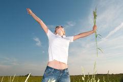Young woman in a beautiful field Stock Photography