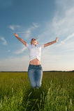 Young woman in a beautiful field Stock Images