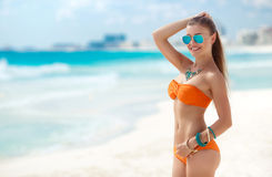 Young woman with a beautiful figure on a tropical beach Stock Photography