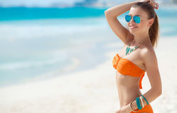 Young woman with a beautiful figure on a tropical beach stock images