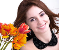 Young Woman and Beautiful garden fresh colorful tulips Royalty Free Stock Photography
