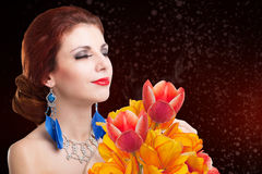 Young Woman and Beautiful garden fresh colorful tulips Royalty Free Stock Image