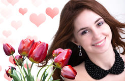 Young Woman and Beautiful garden fresh red tulips Stock Photo