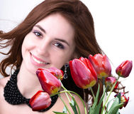Young Woman and Beautiful garden fresh red tulips Royalty Free Stock Photo