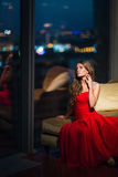 Young woman. Beautiful young girl in the apartment Royalty Free Stock Photo