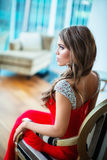Young woman. Beautiful young girl in the apartment Stock Photography