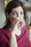 Young Woman with Beautiful Green Eyes Drinking Water stock photography