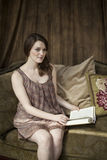 Young Woman with Beautiful Green Eyes Reading a Book. Stock Photos
