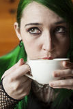 Young Woman with Beautiful Green Hair and Eyes Drinking Coffee stock image