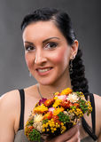 Young woman with beautiful hairstyle and dry bouquet Stock Photo
