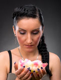 Young woman with beautiful hairstyle and flower Stock Photography
