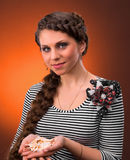 Young woman with beautiful hairstyle holding sea shel Stock Images