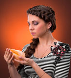 Young woman with beautiful hairstyle holding sea shel Royalty Free Stock Photography