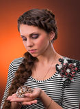 Young woman with beautiful hairstyle holding sea shel Royalty Free Stock Images